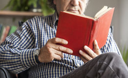 Senior man reading book. Senior man hands reading book Stock Photo