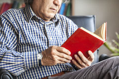 Senior man reading book. Senior man hands reading book Royalty Free Stock Photo