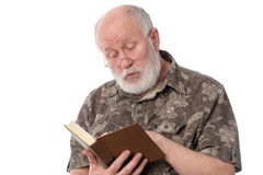 Senior man reading a book, isolated on white Stock Photo