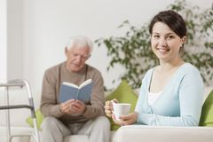 Senior man reading book. Senior men reading book and granddaughter drinking tea Stock Image