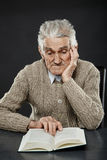 Senior man reading a book Stock Images