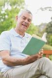 Senior man reading a book at park Royalty Free Stock Photo