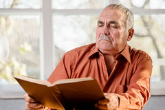 Senior man reading a book Stock Photography