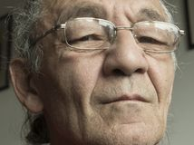 Senior man with reading glasses. Portrait of the senior man with reading glasses Stock Images