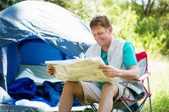 senior man reading beside his tent Royalty Free Stock Photography
