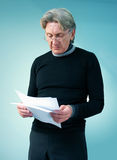 Senior man reading important papers Royalty Free Stock Photo