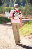Senior man reading map on country walk Royalty Free Stock Photos