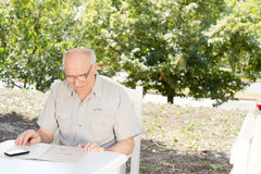 Senior man reading the menu at a restaurant Royalty Free Stock Photo