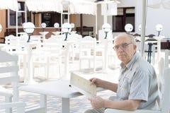 Senior man reading the menu Stock Images