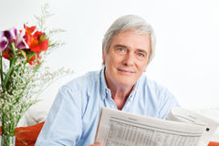 Senior man reading newspaper Royalty Free Stock Photo