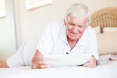 Senior man reading newspaper Stock Photography
