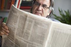 Free Senior Man Reading Newspaper Royalty Free Stock Photography - 83583767