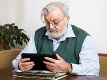 Reading news on tablet Stock Photos