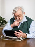 Reading news on tablet Royalty Free Stock Photo