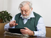 Reading newspaper on tablet Stock Image