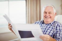 Senior man reading a newspaper Stock Photos