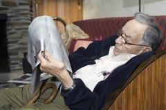 Senior man reading paper Royalty Free Stock Image