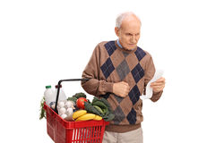 Senior man reading a shopping list Royalty Free Stock Photo