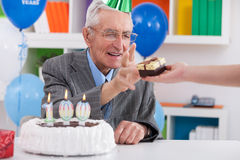 Senior man receiving birthday gift Royalty Free Stock Photo
