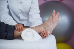 Senior man receiving foot massage from physiotherapist Royalty Free Stock Photography