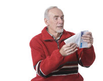 Senior man receiving letter from family. Old man pleased to be opening letter from a family member Royalty Free Stock Photos