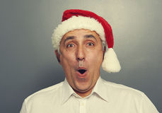Senior man in red christmas hat Stock Photo