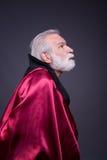 Senior man in red costumes. Stock Photo