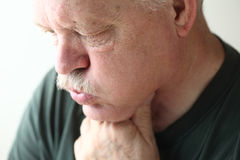 Senior man with reflux Royalty Free Stock Photos