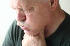 Senior man with reflux Royalty Free Stock Photos
