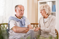 Senior man refusing taking medicament Stock Photo
