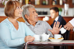 Senior man rejecting coffee in coffee shop Royalty Free Stock Photography