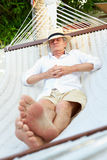 Senior Man Relaxing In Beach Hammock Royalty Free Stock Photography