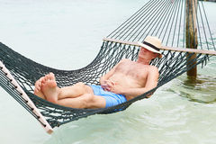 Senior Man Relaxing In Beach Hammock Royalty Free Stock Images