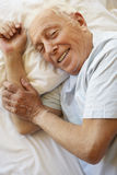 Senior Man Relaxing In Bed Royalty Free Stock Photos