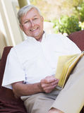 Senior man relaxing with book Stock Image