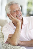 Senior Man Relaxing In Chair Royalty Free Stock Image