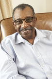 Senior Man Relaxing In Chair At Home Royalty Free Stock Photography