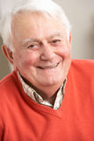 Senior Man Relaxing In Chair At Home Royalty Free Stock Photos