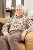 Senior Man Relaxing In Chair At Home Stock Images