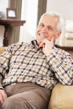 Senior Man Relaxing In Chair At Home Stock Photos