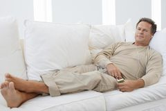 Senior Man Relaxing On Couch Stock Photos