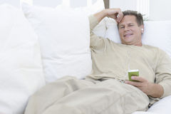 Senior Man Relaxing On Couch Stock Images