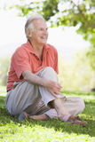 Senior man relaxing in countryside stock image