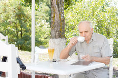 Senior man relaxing with a cup of coffee Royalty Free Stock Images