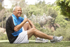 Senior Man Relaxing After Exercise Royalty Free Stock Photos
