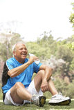 Senior Man Relaxing After Exercise Stock Photography