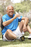 Senior Man Relaxing After Exercise Stock Photo