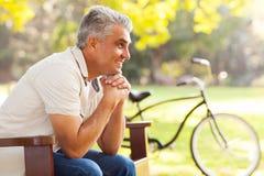 Senior man relaxing. Happy senior man relaxing at the park Stock Photos