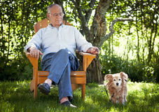 Senior Man Relaxing With His Dog stock photo