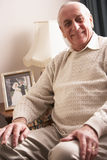 Senior Man Relaxing At Home Royalty Free Stock Photography